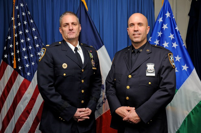 PO Donovan Bunch (right) with Commanding Officer of the 101st Pct. Deputy Inspector Justin Lenz. (Photo: Seth Gottfried)